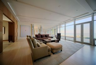 Contemporary Living Room with Wood panel wall, picture window, French doors