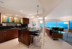 Modern Kitchen with can lights, European Cabinets, large ceramic tile floors, Kitchen island, Breakfast nook, flush light