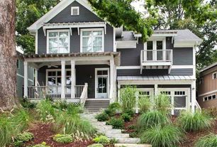 Traditional Exterior of Home with Stone steps, Glass panel door, Transom window, French doors, Entry, Covered porch, Pathway
