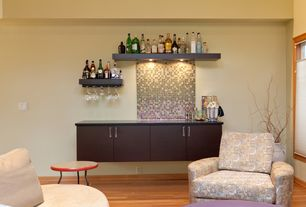 Modern Bar with Standard height, specialty window, can lights, Built-in bookshelf, Hardwood floors