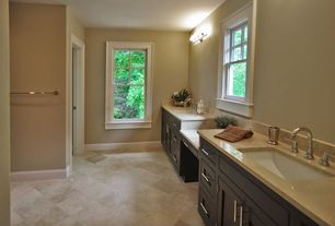 Contemporary Master Bathroom with Wall sconce, Corian Solid Surface Countertop in Aurora, limestone tile floors, Double sink
