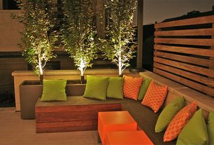 Contemporary Deck with World Market Green Outdoor Throw Pillow, Fence, Raised beds, Cb2 Cube Table-planter