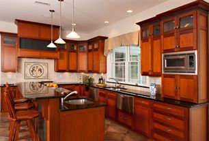 Craftsman Kitchen with Pendant light, Custom hood, L-shaped, Flat panel cabinets, Kitchen island, Simple granite counters