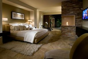 Contemporary Master Bedroom with MS International Golden Sienna Travertine, Skyline furniture panel bed, stone fireplace