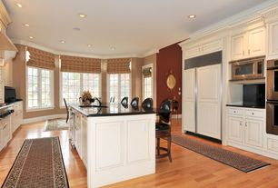 Traditional Kitchen with Corian Solid Surface Countertop in Deep Nocturne, Maple - Natural 2 1/4 in. Solid Hardwood Strip