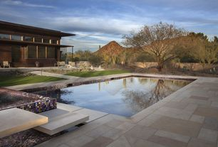 Contemporary Hot Tub with Fence, exterior stone floors, Iridescent mosaic tiles, Pathway, Natural stone tiles, picture window