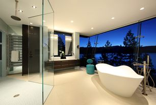 Modern Master Bathroom with Signature Hardware - Iredell Acrylic Freestanding Tub, Limestone counters, Raised panel, Flush