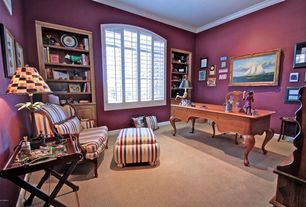 Country Home Office with Crown molding, Carpet, Arched window, Built-in bookshelf
