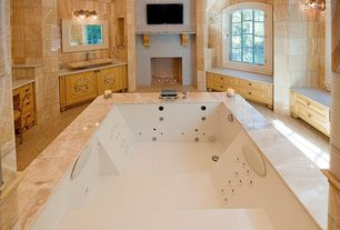 Traditional Master Bathroom with Pental stratus vein cut honed travertine, Jetted, Arched window, Flush, Travertine counters
