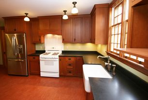 Craftsman Kitchen with flush light, Farmhouse sink, L-shaped, Soapstone, Vinyl floors, Soapstone counters, Inset cabinets