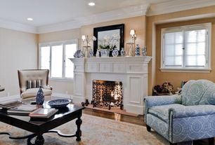 Traditional Living Room with interior wallpaper, Wall sconce, Crown molding, Cement fireplace, Hardwood floors