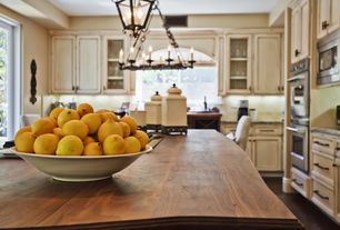 Country Kitchen with Pendant light, Glass panel, Flush, L-shaped, Simple granite counters, Kitchen island, Limestone