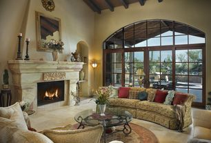 Mediterranean Living Room with Arched window, Concrete tile , Transom window, French doors, stone fireplace, Exposed beam