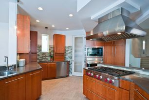 "Contemporary Kitchen with European Cabinets, Soapstone counters, French doors, Subway Tile, Wolf pi363418 36"" pro island hood"