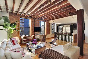 Modern Great Room with Columns, Hardwood floors, interior brick, Exposed beam
