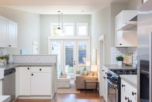 Contemporary Kitchen with Flat panel cabinets, Cameron roll slipcovered storage ottoman, Subway Tile, Farmhouse sink, Flush
