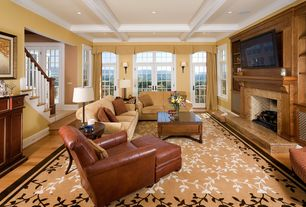 Traditional Living Room with Built-in bookshelf, Hardwood floors, Wall sconce, Standard height, French doors, Box ceiling