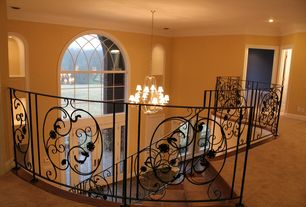 Traditional Staircase with Arched window, French doors, Carpet, picture window, Loft, curved staircase, Cathedral ceiling
