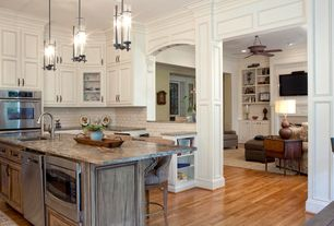 Traditional Kitchen with Antique drop leaf side table, Walnut cabinets, Paint, Ann sacks ceramic wall tile, Wainscotting