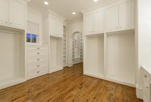 Traditional Closet with Crown molding, Hardwood floors, California Closets Custom Wardrobe, Built-in bookshelf