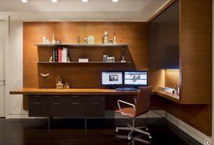 Modern Home Office with Hardwood floors, Built-in bookshelf