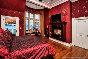 Traditional Master Bedroom with Bay window, Ceiling fan, Crown molding, interior wallpaper, metal fireplace, Hardwood floors
