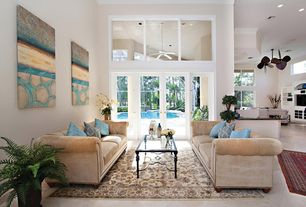 Modern Living Room with French doors, High ceiling, Crown molding, travertine tile floors, Porcelain floor and wall tile