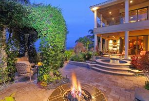 Mediterranean Patio with Fire pit, Raised beds, exterior stone floors, Arbor