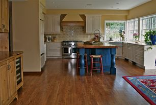 Country Kitchen with mexican tile backsplash, Soapstone counters, Lg hausys viatera-quartz countertop in sella, Custom hood