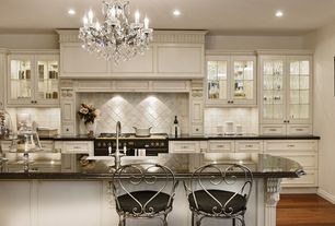 Traditional Kitchen with Schonbek madison collection six light crystal chandelier, Glass panel, Farmhouse sink, Custom hood