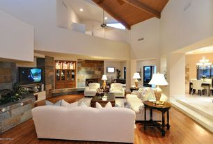 Traditional Living Room with Cathedral ceiling, Hardwood floors, Columns, Ceiling fan, Exposed beam, insert fireplace, Loft