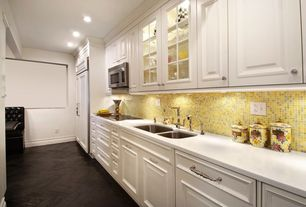 Traditional Kitchen with Undermount sink, Glass Tile, Raised panel, Dupont Corian Designer White, Breakfast nook, Glass panel