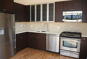 Contemporary Kitchen with Built In Refrigerator, European Cabinets, Undermount sink, Hardwood floors, Standard height, Flush