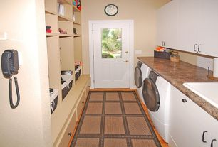 Eclectic Laundry Room with Glass panel door, Farmhouse sink, Built-in bookshelf, simple marble floors, Carpet