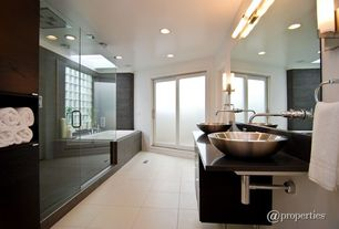 Contemporary Master Bathroom with wall-mounted above mirror bathroom light, European Cabinets, Bathtub, Frameless shower door