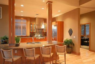 Modern Kitchen with can lights, Large Ceramic Tile, Flat panel cabinets, electric cooktop, Hardwood floors, Glass panel