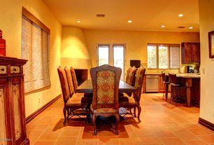 Mediterranean Dining Room with terracotta tile floors, Built-in bookshelf, French doors