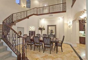 Mediterranean Dining Room with High ceiling, Arched window, travertine floors, Wall sconce