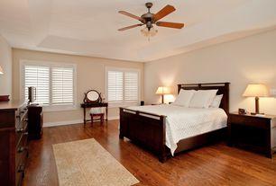 Modern Guest Bedroom with Laminate floors, Ceiling fan, Chandelier