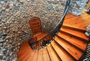 Rustic Staircase with High ceiling, Wrought iron railing, Stacked stone wall facade, Hardwood floors