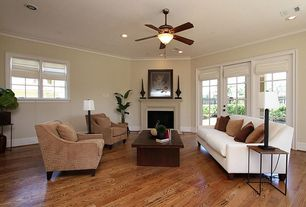 Modern Living Room with Ceiling fan, Hardwood floors, can lights, Casement, Cement fireplace, Fireplace, Crown molding