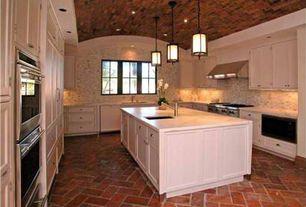 Mediterranean Kitchen with Interlocking Pavers, Pental hauteville yellow polished limestone, Pendant light, High ceiling