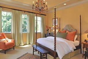 Traditional Guest Bedroom with Casement, can lights, Chandelier, Crown molding, Standard height, Carpet