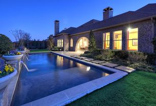 Traditional Swimming Pool with double-hung window, Pathway, Lap pool, exterior concrete tile floors, Arched window, Fence