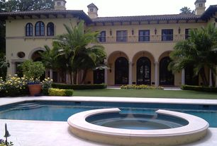 Mediterranean Swimming Pool with French doors, Pool with hot tub, Pathway, exterior stone floors, specialty window