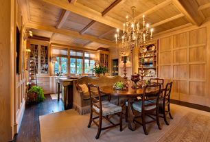 Country Dining Room with Built-in bookshelf, Crown molding, Hardwood floors, Chandelier, Exposed beam, Pendant light
