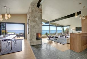 Modern Great Room with Hardwood floor, Mid-century glass pendant, Vaulted ceiling, Open concept, Water view, Slate floor