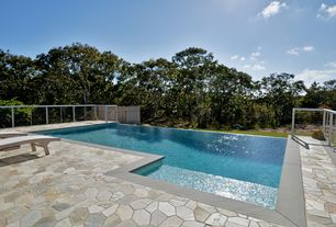 Contemporary Swimming Pool with Fence, Infinity pool, exterior stone floors