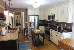 Country Kitchen with Granite Solid Surface Countertop in Deep Nocturne, Built-in bookshelf, Pendant light, flush light