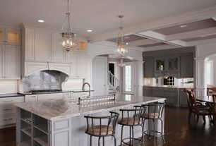 Traditional Kitchen with Soapstone counters, Columns, Custom hood, Hardwood floors, Flat panel cabinets, Archways, L-shaped